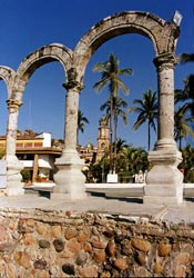 The famed arches, Los Arcos, on el Malecón with the bell tower of the Cathedral de la virgen Guadalupe.