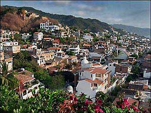 "Gringo Gulch is a hilly district of the Old Town of Puerto Vallarta - don't miss the Liz Taylor/Richard Burton villas joined by the locally named ""The Bridge of Screams!"""